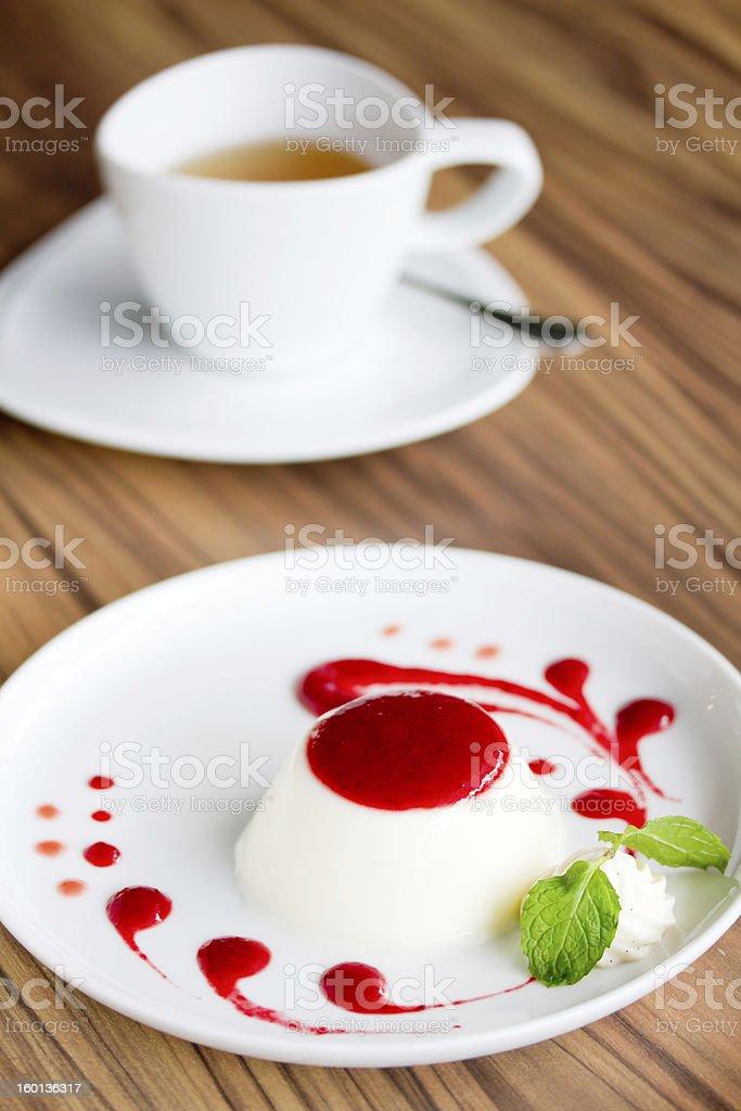 Panna cotta with Raspberry Sauce royalty-free stock photo