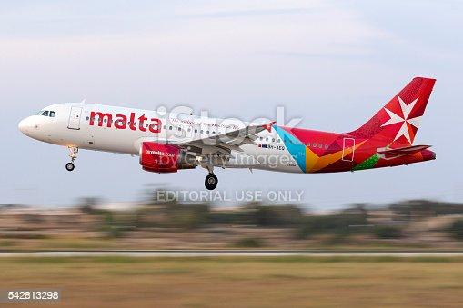 istock Panned shot of an Airmalta Airbus landing 542813298