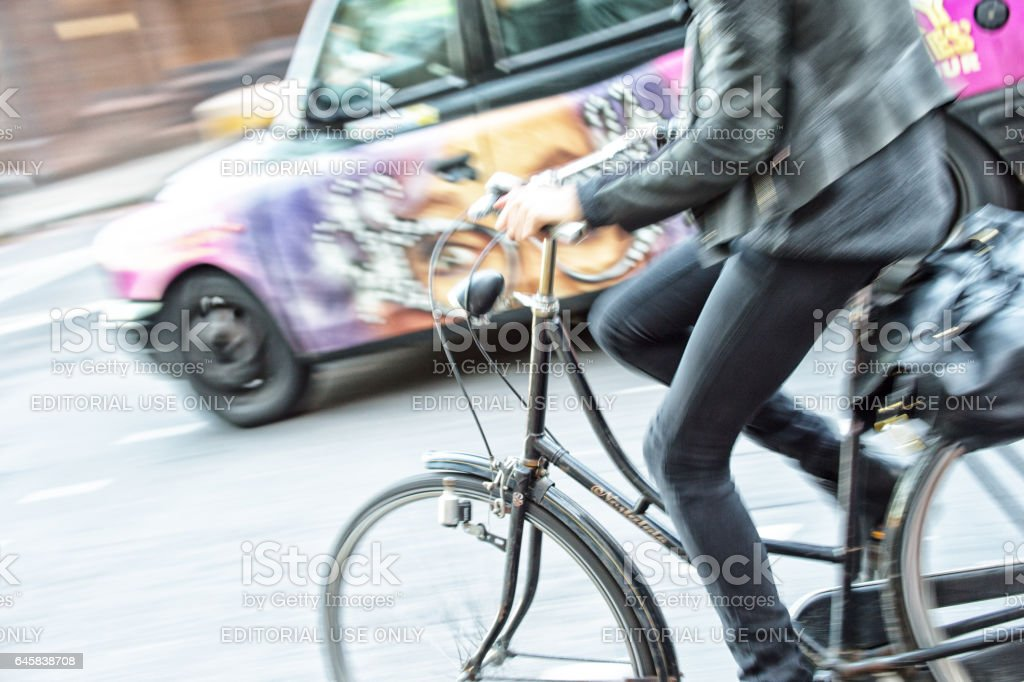 Panning blurred London bicyclist in profile stock photo