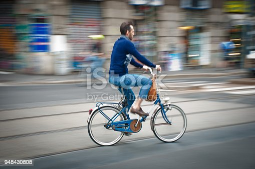 863454090istockphoto panning cyclist in the city 948430808