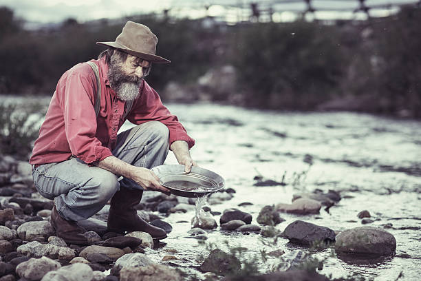 Panning for Gold Old man panning for Gold. 20th century style stock pictures, royalty-free photos & images