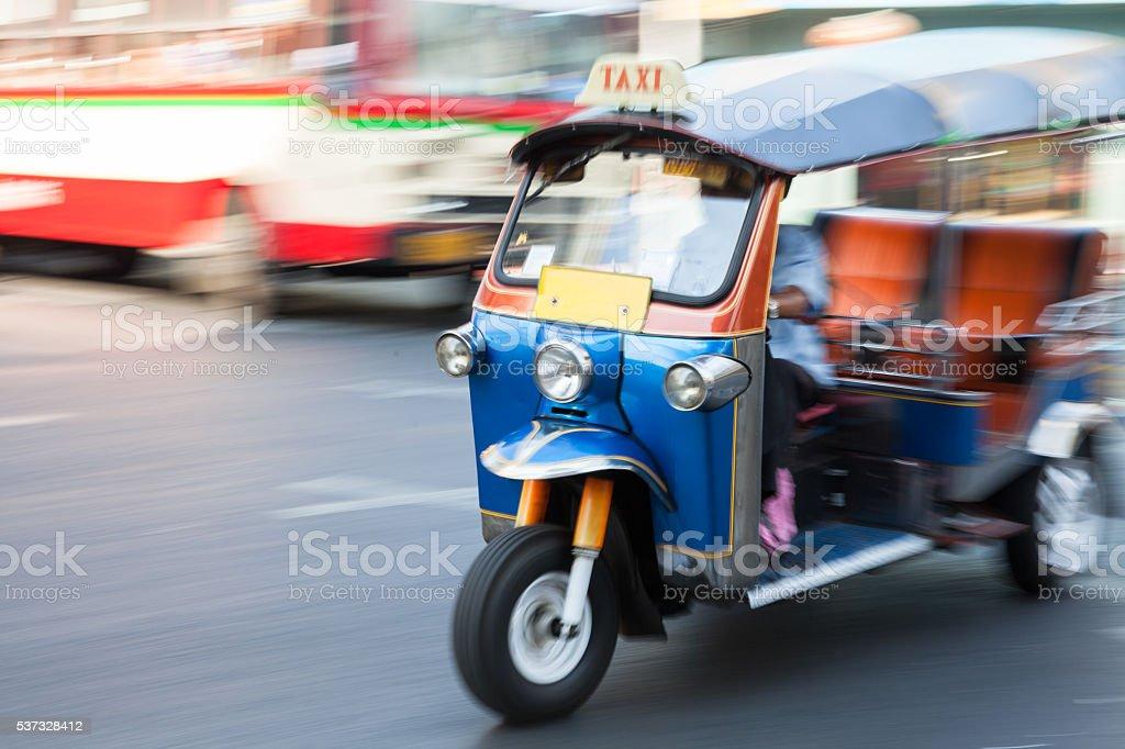 Panning of man riding tuk-tuk stock photo