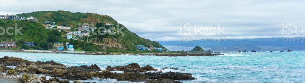 Panonamic image of Taputeranga Marine Reserve is located on Wellington  's South coast covering Island Bay , Owhiro Bay and  Houghton Bay , Wellington , North Island of New Zealand royalty-free stock photo
