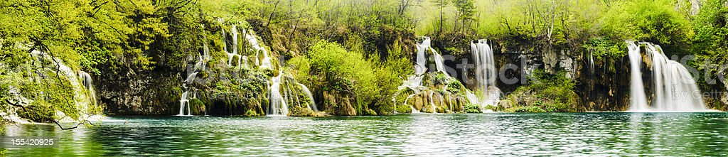 Panorama - a series of waterfalls along lake royalty-free stock photo