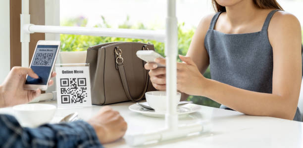 Panorama Asian customer scanning QR code for online menu un new normal restaurant stock photo