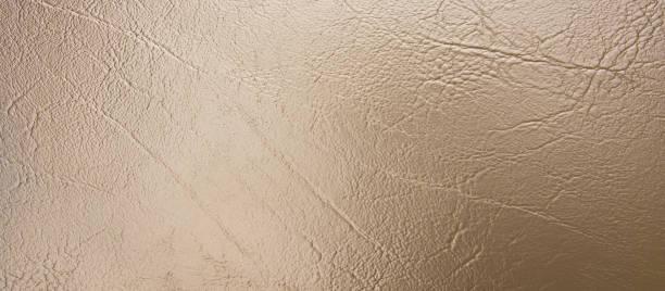 panorama bronze leder textur hintergrund. blasse bronze lederstruktur - glitter farbige wände stock-fotos und bilder
