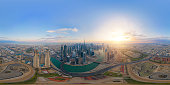 360 panorama by 180 degrees angle seamless panorama of aerial view of Dubai Downtown skyline and highway, United Arab Emirates or UAE. Financial district in urban city. Skyscraper buildings at sunset.