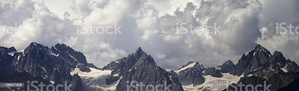 Panorama Caucasus Mountains in clouds royalty-free stock photo