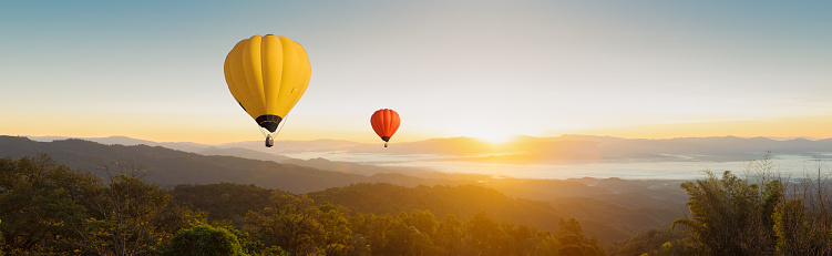 Panorama Colorful Balloons Floating In The Sky In The Mountain Landscape In The Morning Stock Photo - Download Image Now