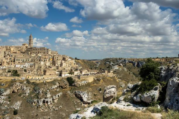 Panorama di Matera con il canyon della Gravina Panorama di Matera e Canyon della Gravina mattock stock pictures, royalty-free photos & images