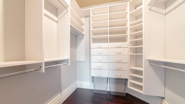 Panorama frame Fully fitted empty white walk-in wardrobe bright interior stock photo