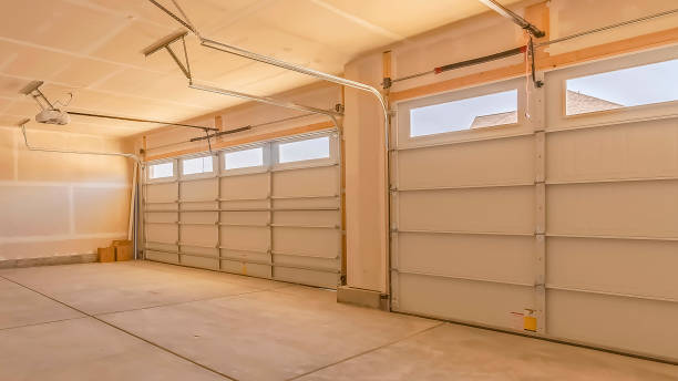 Panorama frame Interior of an empty garage with two large doors and small rectangular windows stock photo