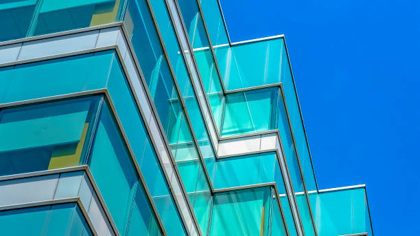 Panorama frame Modern building exterior viewed from below with blue sky in the background stock photo