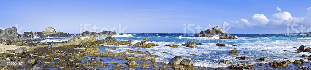 Panorama from a natural pool in the wild ocean Aruba royalty-free stock photo