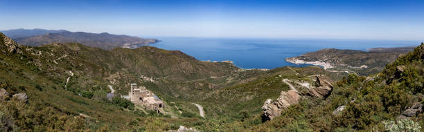 Panorama from top of Serra De Roses hill of  Sant Pere de Rodes monastery and Selva city stock photo