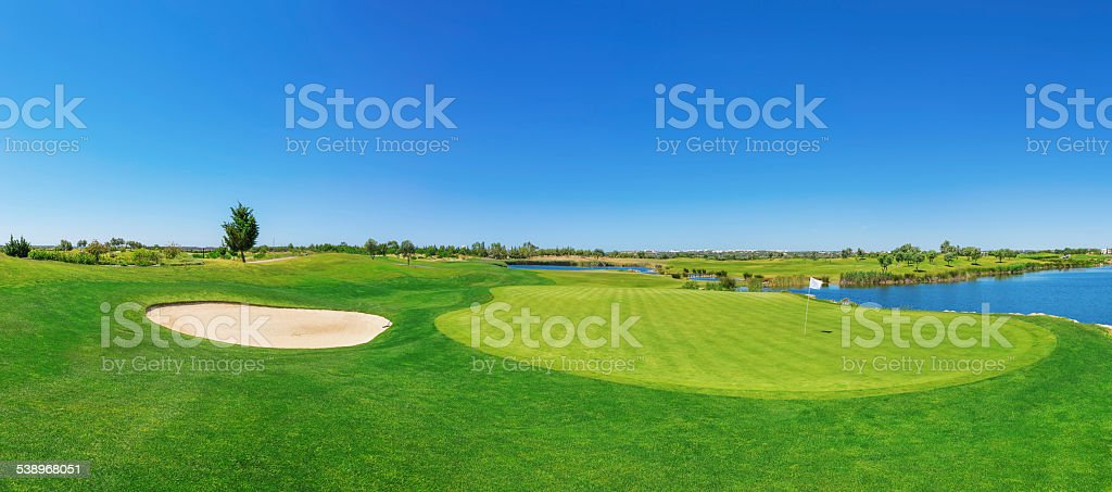 Panorama golf course lush grass. On the lake. stock photo