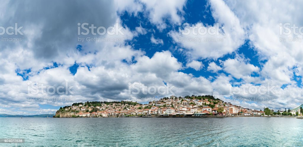 Panorama, historical part of unesco listed town ohrid is located next to the ohrid lake and spread all over the hill with fortress of tzar samuel at the top stock photo