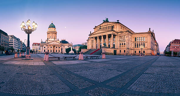 Panorama image of Gendarmenmarkt in Berlin at dawn Panorama image of Gendarmenmarkt square in Berlin with German church and Concert Hall at dawn gendarmenmarkt stock pictures, royalty-free photos & images