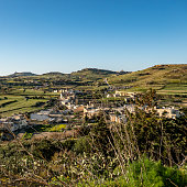 panorama of the countryside village and hills of Gozo-Malta with the sea on the horizon