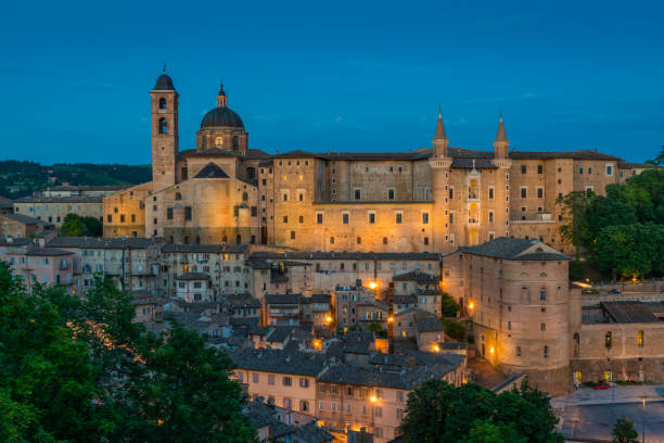 panorama in urbino in the evening, city and world heritage site in the marche region of italy. - della stock pictures, royalty-free photos & images
