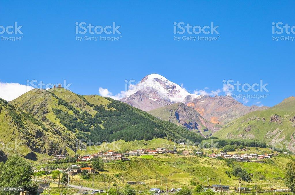 Panorama Kazbek and the surrounding mountain landscape stock photo