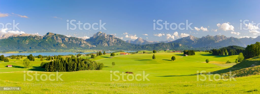 Panorama landscape in Bavaria, Germany, with alps mountains and lake at spring stock photo