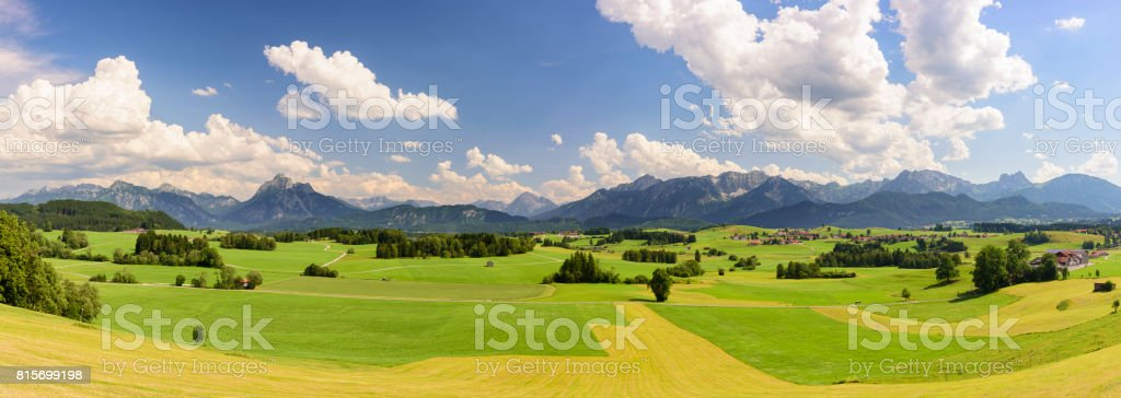 panorama landscape in Bavaria with meadow and alps mountains stock photo