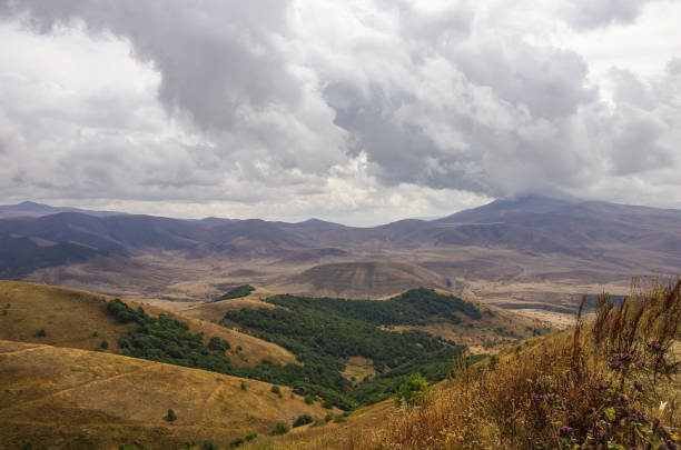 Panorama mountains near Jermuk spa resort city and Arpa river canyon form ropeway station. Armenia. Panorama mountains near Jermuk spa resort city and Arpa river canyon form ropeway station. Armenia. ARPA stock pictures, royalty-free photos & images