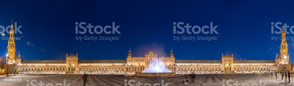 Panorama night view of Plaza de Espana in Seville stock photo