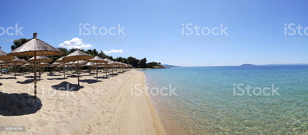 Panorama of a beach and turquoise water stock photo