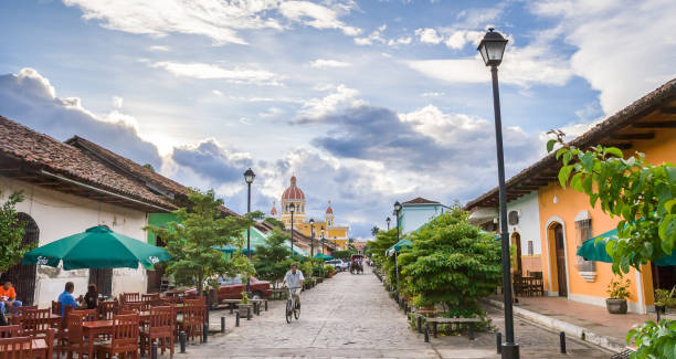Panorama of a colorful street in Granada, Nicaragua  with the cathedral in the background stock photo