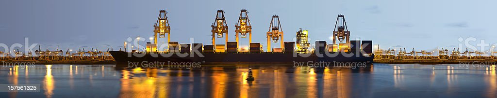 Panorama of a container terminal at dusk royalty-free stock photo