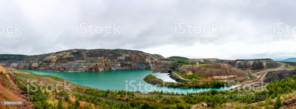 Panorama of a flooded quarry стоковое фото