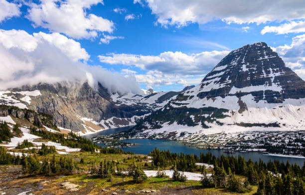 panorama of a high mountain lake - hidden lake in the rocky mountains of glacier national park montana. usa - us glacier national park stock pictures, royalty-free photos & images