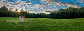 istock Panorama of a lawn field with lacrosse goals stored and locked together in Veteran's park in Lexington, KY USA during sunrise 1276634455