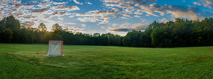 Field for playing lacrosse sport early in the morning with goals put together