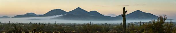 Panorama of a rare morning fog in the Phoenix Sonoran Desert Preserve stock photo