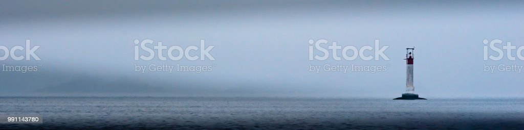 panorama of a river marker bouy in the Thousand Islands, St. Lawrence River on a foggy morning. stock photo