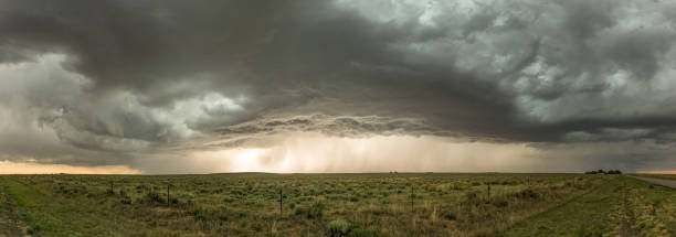 panorama of a severe thunderstorm over the great plains - cielo minaccioso foto e immagini stock