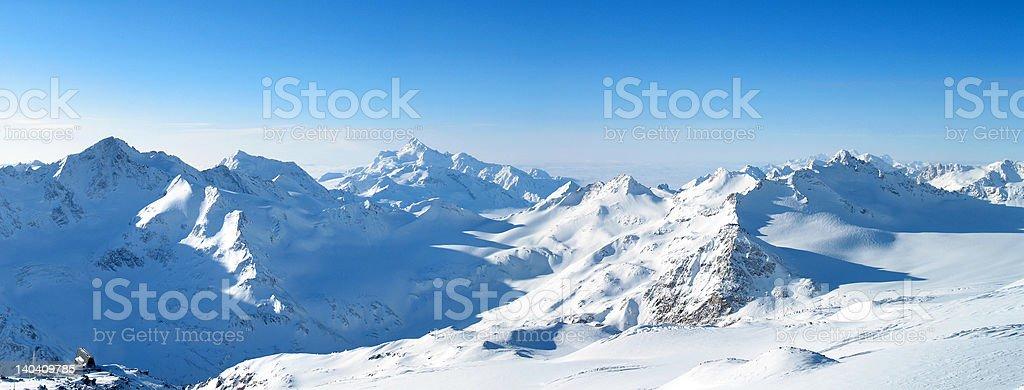Panorama of a snowcapped mountain range royalty-free stock photo