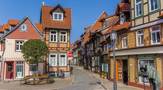 Panorama of a statue in front of colorful houses in Wernigerode, Germany