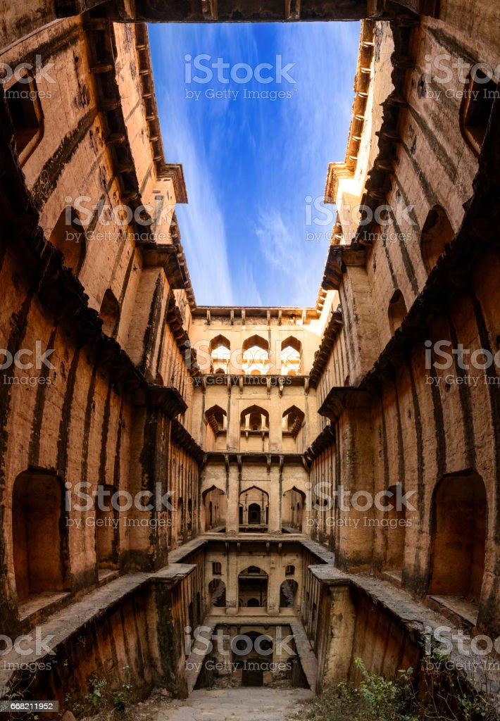 Panorama of a stepwell / baori architecture, situated in a village of Rajasthan stock photo