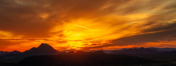 Panorama of a vivid sunset over the mountains and desert of the Sonoran Desert stock photo