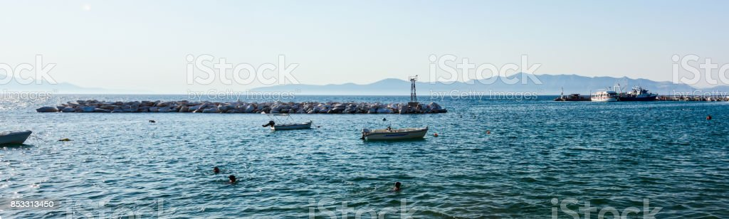 Panorama of an artificial reef as protection for ships stock photo