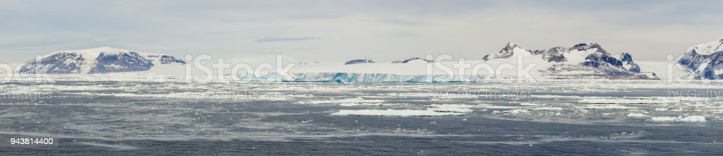 Panorama of Antarctic Landscape with Mountains stock photo