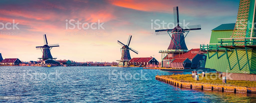 Panorama of authentic Zaandam mills on the water channel stock photo