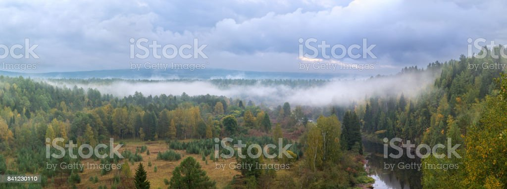 Panorama of autumn forest in a natural park of deer streams stock photo