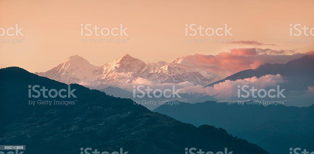 Panorama of beautiful Himalayan mountains during sunset stock photo