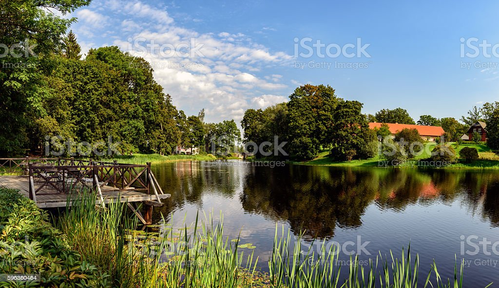 Panorama of beautiful lake with small wooden pier in Latvia royalty-free stock photo