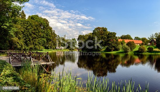 Panorama of beautiful lake with small wooden pier in Latvia